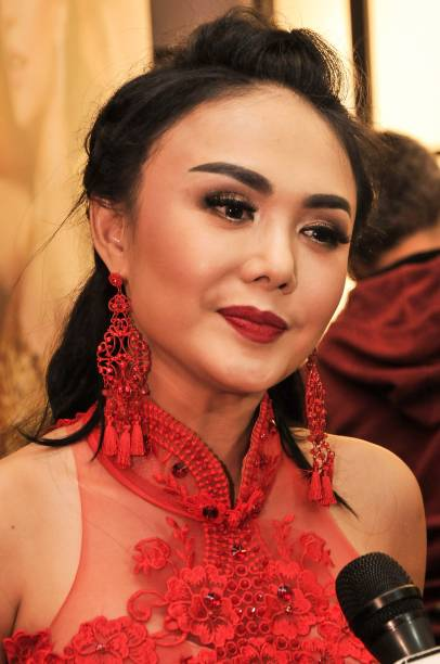 This picture taken on february 11 2018 shows indonesian singer yuni this picture taken on february 11 2018 shows indonesian singer yuni shara speaking during a reheart Choice Image