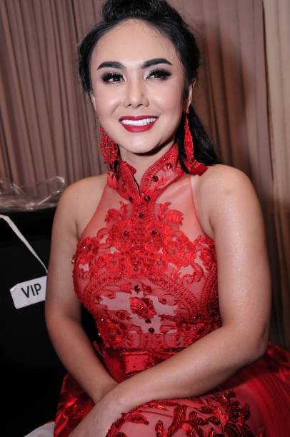 This picture taken on february 11 2018 shows indonesian singer yuni this picture taken on february 11 2018 shows indonesian singer yuni shara posing during a reheart Image collections