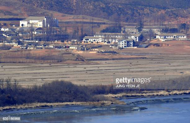 This picture taken on February 12 2017 shows a North Korean guard post in the border county of Kaepoong as seen from a South Korean observation post...