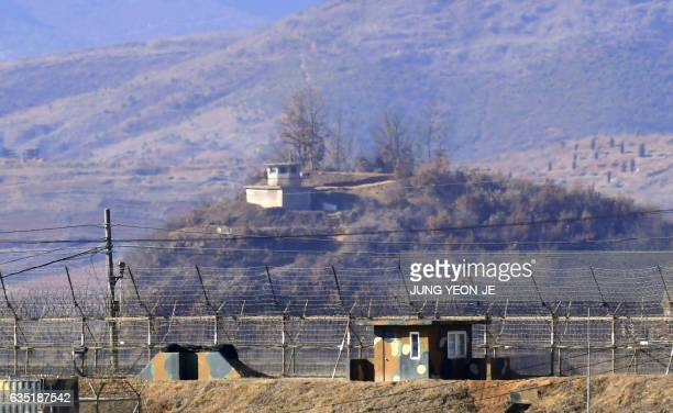 This picture taken on February 12 2017 shows military guard posts of South Korea and North Korea FACING each other as seen from the border city of...