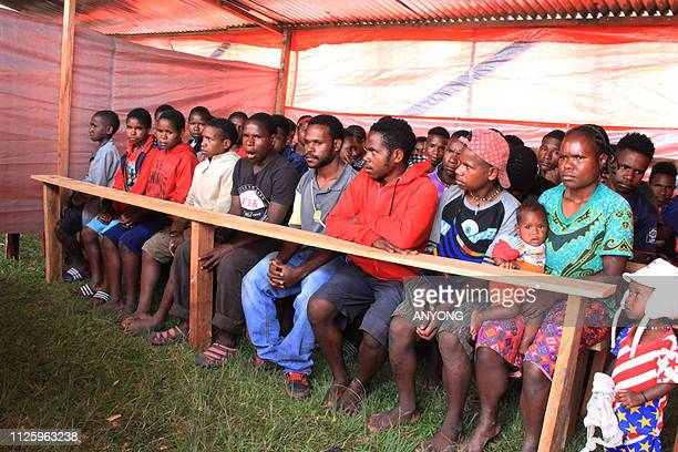 This picture taken on February 12, 2019 shows Papuans at a temporary shelter in Wamena, Indonesia's Papua province. - Hundreds of students have fled...