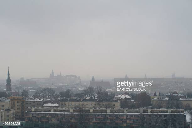 This picture taken on February 13 2013 shows a smog over Krakow Poland The thick grey layer of smog blanketing Poland's southern city of Krakow is...