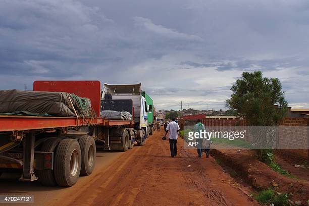 This picture taken on February 13 2014 shows lorries blocked in Kasumbalesa a Congolese town at the border between DR Congo and Zanbia After border...
