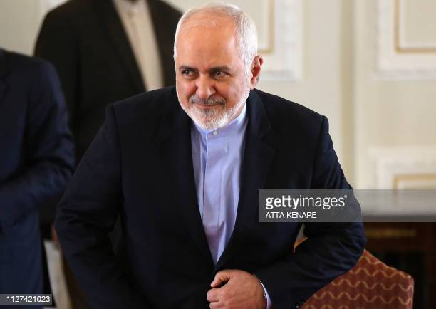 This picture taken on February 13 2019 shows Iran's Foreign Minister Mohammad Javad Zarif gesturing during a press conference in Tehran Zarif who was...