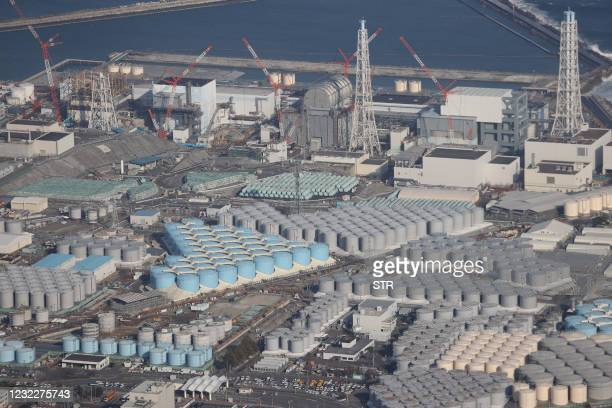 This picture taken on February 14, 2021 shows an aerial view of the TEPCO's Fukushima Daiichi Nuclear Power Plant undergoing decommissioning work and...