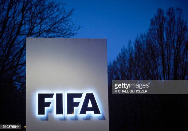 This picture taken on February 15 2016 shows the logo of the International Federation of Association Football at the FIFA headquarters in Zurich The...