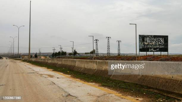 This picture taken on February 15 2020 shows a view of an empty section of the highway connecting the northern Syrian city of Aleppo with the capital...