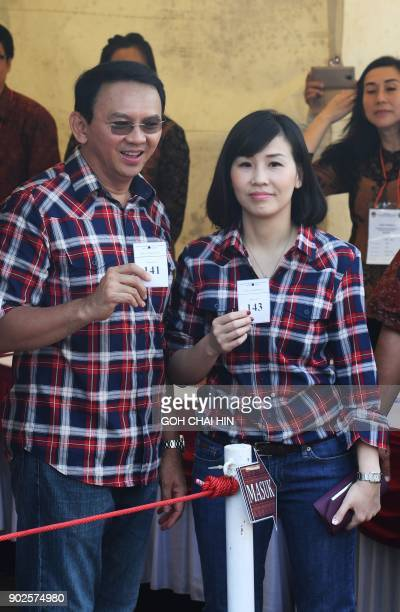 This picture taken on February 15 shows Jakarta's Christian governor Basuki Tjahaja Purnama known as 'Ahok' posing for a picture with his wife...