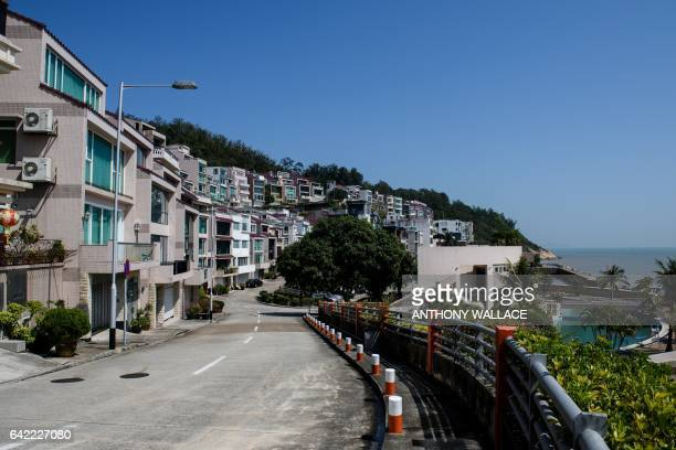 This picture taken on February 16 2017 shows the street outside an oceanfront villa one of the properties where Kim JongNam halfbrother of a North...