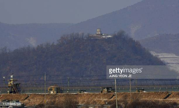 This picture taken on February 16 2019 shows military guard posts of South Korea and North Korea standing opposite each other as seen from in the...