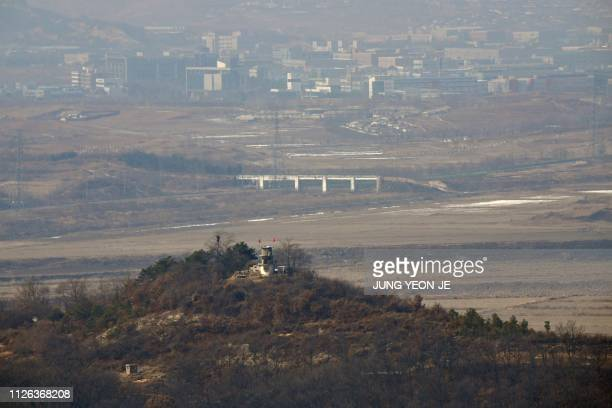 This picture taken on February 16, 2019 shows North Korea's Kaesong joint industrial complex area past a North Korean military guard post as seen...