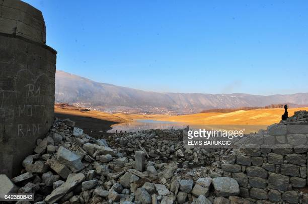 This picture taken on February 16 shows a the ruins of a sunken mosque and nearby graveyards as evidence of human habitation in the past on the...