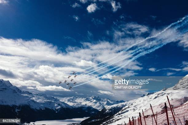 This picture taken on February 17 shows the PC7 aerobatics team of the Swiss Air Force flying over the finish area at 2017 FIS Alpine World Ski...