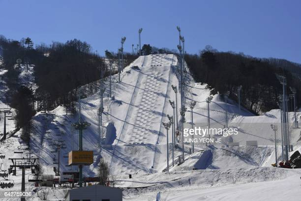 This picture taken on February 18 2017 shows a general view of moguls venue at Bokwang Phoenix Snow Park the venue of the freestyle skiing and...