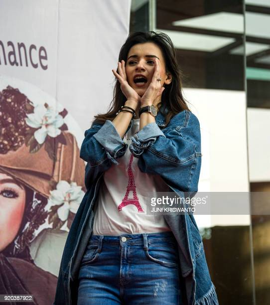This picture taken on February 18 2018 shows Indonesian actress Shakira Alatas during a promotional event in Surabaya / AFP PHOTO / Juni Kriswanto