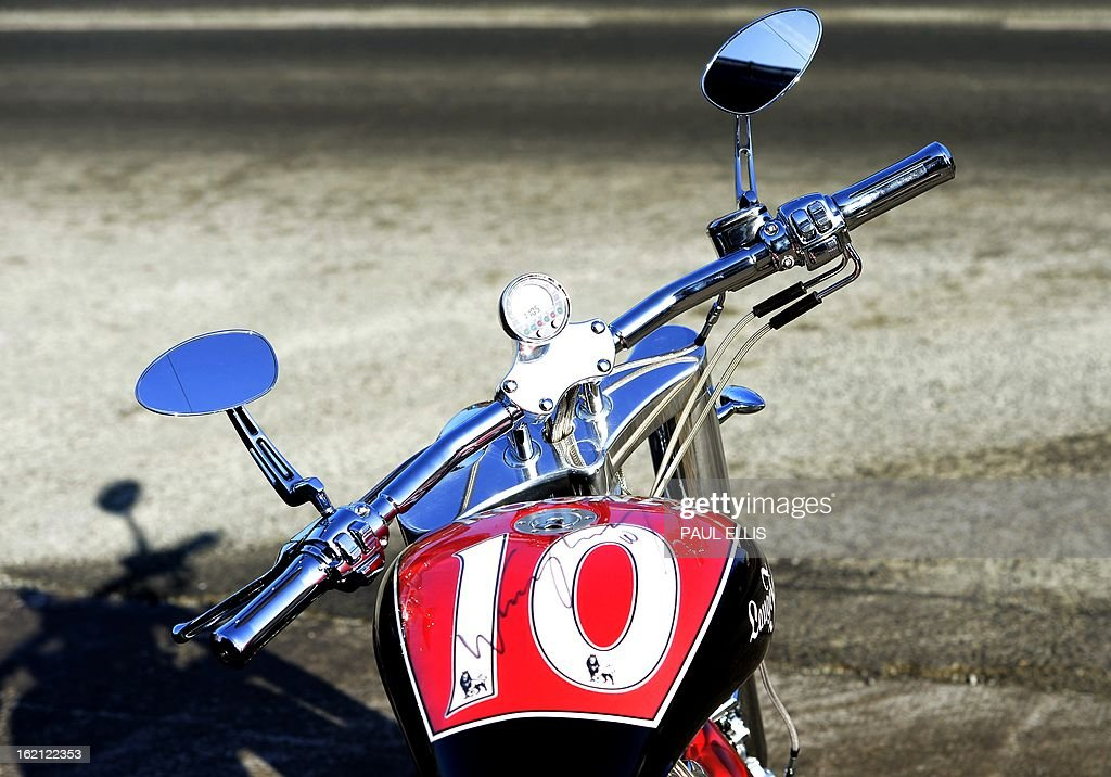 This picture taken on February 19, 2013 shows detail on a motorcycle designed by Manchester United and England footballer Wayne Rooney as it is displayed in Chester, north west England on February 19, 2013 ahead of an auction where it is believed it could fetch between £40,000 and £60,000 in aid of charity. The 2012 Lauge Jensen cruiser-style machine, designed by the world-famous striker and custom-made by the Danish motorcycle manufacturer will go under the hammer on February 20, 2013 on behalf of KidsAid, a Danish charitable foundation that helps young people affected by illness. AFP PHOTO/Paul Ellis