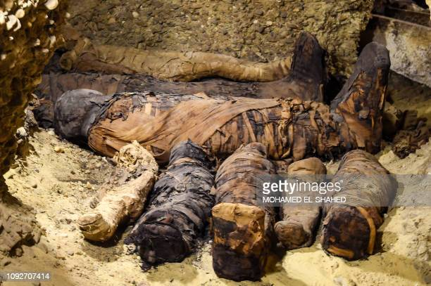 This picture taken on February 2 2019 shows newlydiscovered mummies wrapped in linen found in burial chambers dating to the Ptolemaic era at the...