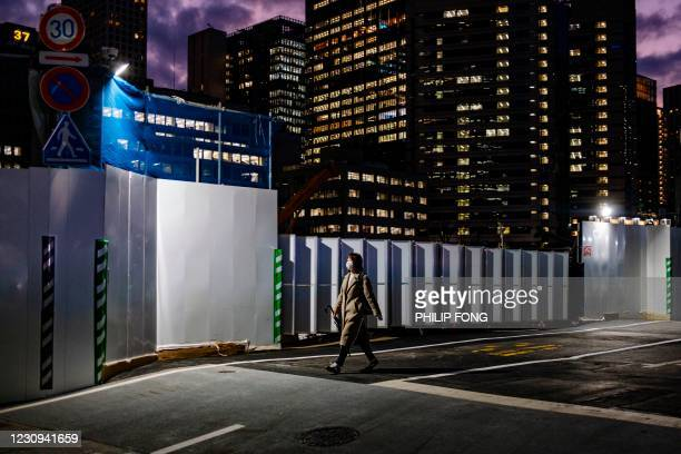 This picture taken on February 2, 2021 shows a woman walking on a street in Tokyo. / The erroneous mention[s] appearing in the metadata of this photo...