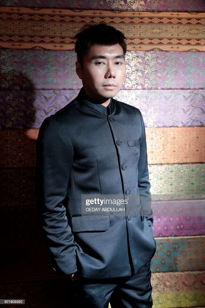 This picture taken on February 20, 2018 shows Indonesian TV psychic Roy Kiyoshi posing during a promotional event in Jakarta. / AFP PHOTO / Oeday Abdullah