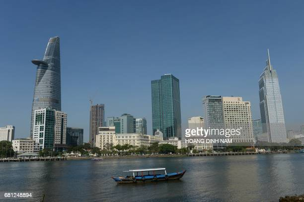 This picture taken on February 21 2017 shows new highrise buildings in the very centre Ho Chi Minh City seen from the other side of Saigon river They...