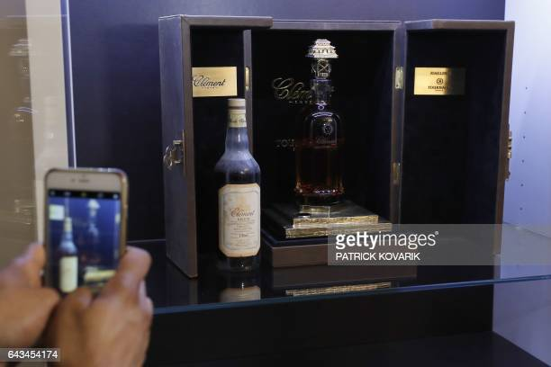 This picture taken on February 21 shows the world's most expensive rhum bottle sold in auction to raise money for an association fighting sick cells...