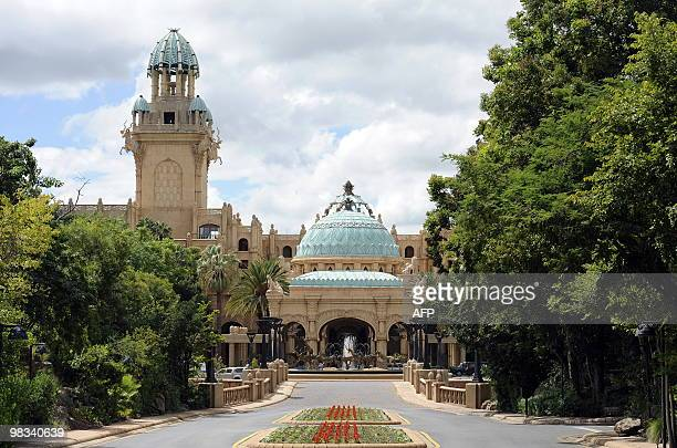This picture taken on February 22 2010 shows the Palace hotel of Lost City in Sun City The shaking walkway leading to a manmade sandy beach is...
