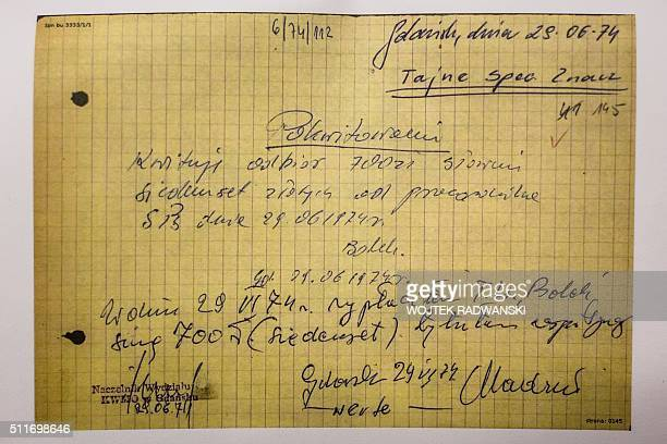 """This picture taken on February 22, 2016 at Polish Institute for National Remembrance in Warsaw shows a money bill signed by """"Bolek"""", one of several..."""