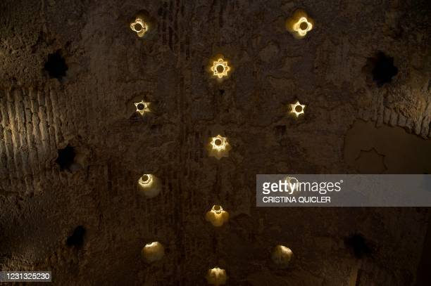 This picture taken on February 22, 2021 in Seville shows the ceiling of the Giralda Bar where an Islamic 12th-century bathhouse was uncovered during...