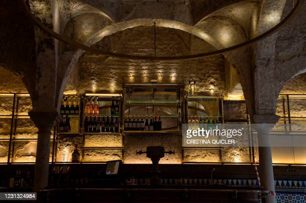 This picture taken on February 22, 2021 in Seville shows the counter of the Giralda Bar where an Islamic 12th-century bathhouse was uncovered during...