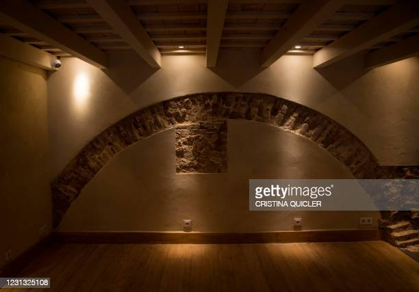 This picture taken on February 22, 2021 shows a wall at the Giralda Bar in Seville, where an Islamic 12th-century bathhouse was uncovered during...