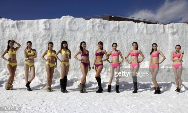 This picture taken on February 23 2013 shows contestants posing in swimsuits during a beauty contest at a ski resort in Shenyang northeast China's...