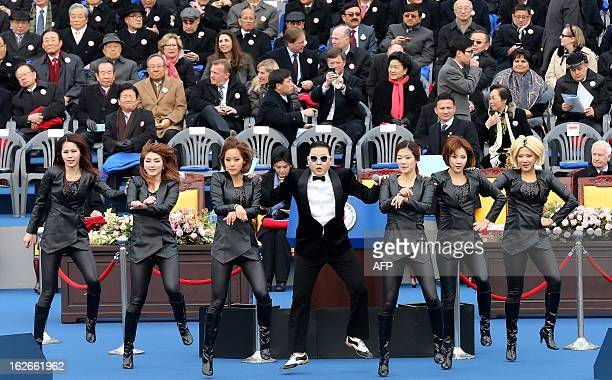 This picture taken on February 25 2013 shows South Korean rapper Psy performing his hitsong 'Gangnam Style' at the inauguration ceremony of Korea's...