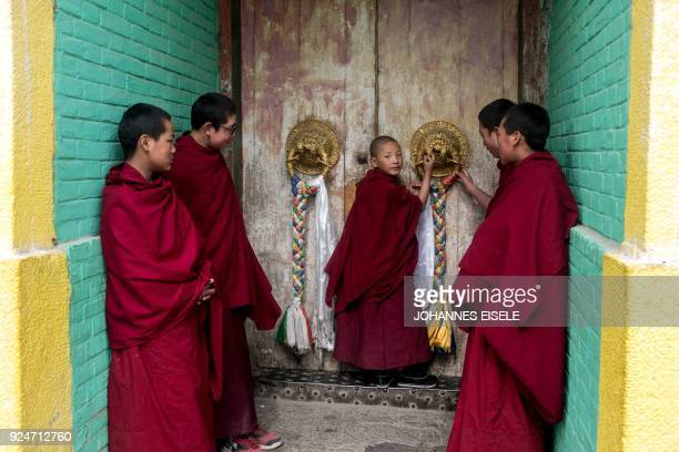 TOPSHOT This picture taken on February 26 2018 shows Tibetan monks at the Longwu Temple during Tibetan New Year celebrations in Tongren on the...