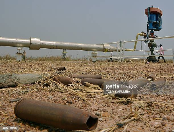 This picture taken on February 28 2015 shows spent munitions lying on the ground at an abandoned oil treatment facility at Thar Jath in Unity State...