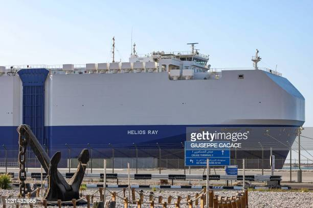 This picture taken on February 28, 2021 shows a view of the Israeli-owned Bahamian-flagged MV Helios Ray cargo ship docked in Dubai's Mina Rashid...