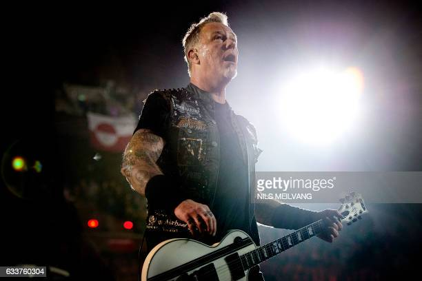 This picture taken on February 3 2017 shows Metallica's American lead vocalist and rhythm guitarist James Hetfield as he performs during the opening...
