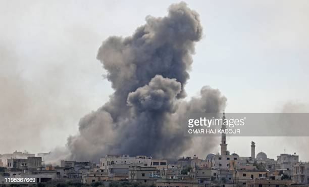 This picture taken on February 3, 2020 shows smoke plumes billowing in the Syrian village of al-Nayrab, about 14 kilometres southeast of the city of...