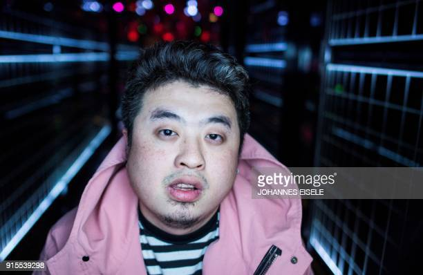 This picture taken on February 5 2018 shows Shanghai rapper Mr Trouble Hong Tianlin posing outside his studio in Shanghai Chinese rap and hip hop...