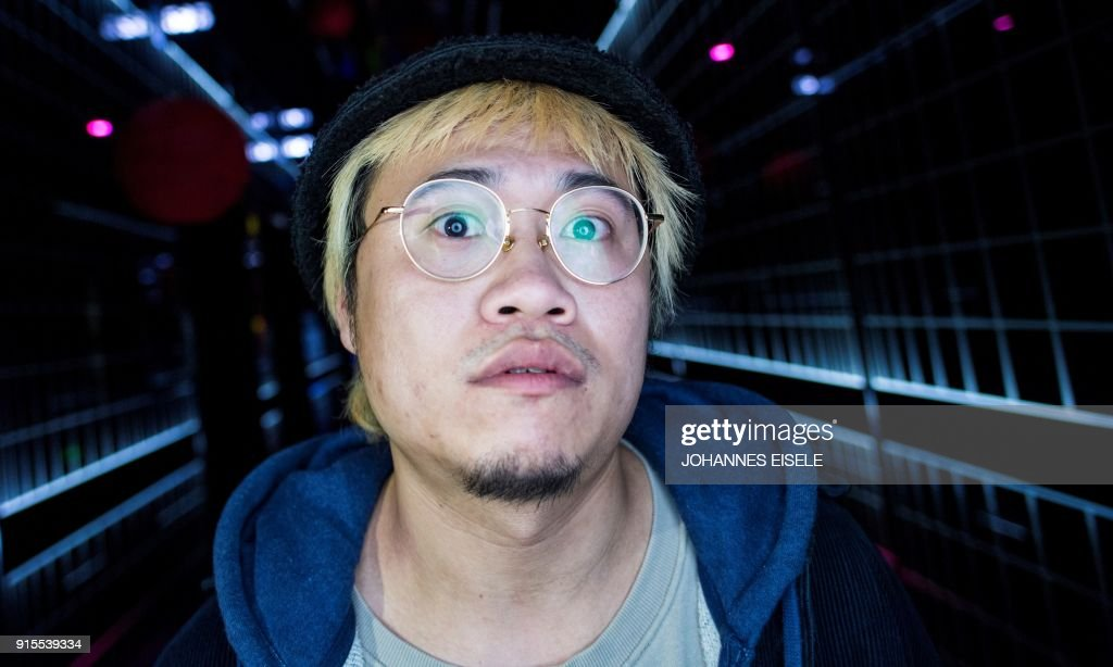 This picture taken on February 5, 2018 shows Shanghai rapper Naggy posing for a picture outside his studio in Shanghai. Chinese rap and hip hop seemed poised to break out after a wildly popular singing show, but an abrupt backlash has tamed the swagger of artists who fear the music scene will be nipped in the bud by Communist politics. / AFP PHOTO / Johannes EISELE / TO GO WITH China-culture-music-rap-censorship,FOCUS by Dan Martin