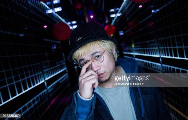 This picture taken on February 5 2018 shows Shanghai rapper Naggy posing for a picture outside his studio in Shanghai Chinese rap and hip hop seemed...