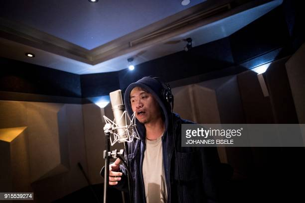 This picture taken on February 5 2018 shows Shanghai rapper Naggy singing in his studio in Shanghai Chinese rap and hip hop seemed poised to break...