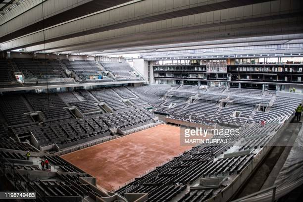 This picture taken on February 5, 2020 at the Roland Garros stadium in Paris shows the construction work of the newly built roof of the Philippe...