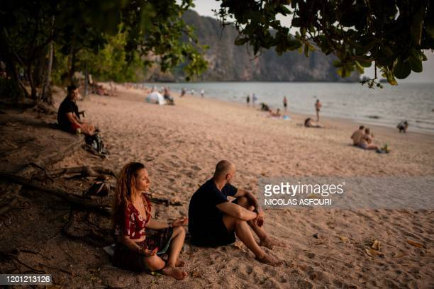 This picture taken on February 6, 2020 shows a woman meditating at Ao Nang beach in Krabi province.