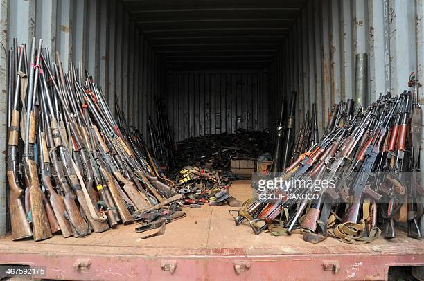 This picture taken on February 7 at the Mpoko camp in Bangui, shows weapons gathered by French soldiers of the Sangaris military operation and seized...