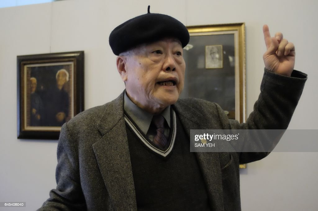 This picture taken on February 8, 2017 shows Pan Hsin-hsing, the son of a '228 Victim' which is used to refer to those executed in the February 28, 1947 incident, gestures during an interview in Taipei. Seventy years after the White Terror purges began in Taiwan the relatives of those who died are still seeking justice.