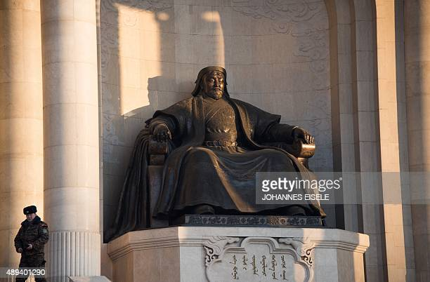 This picture taken on February 9 2015 shows the statue of Genghis Khan in front of the Parliament House on Sukhbaatar Square in Ulan Bator AFP PHOTO...