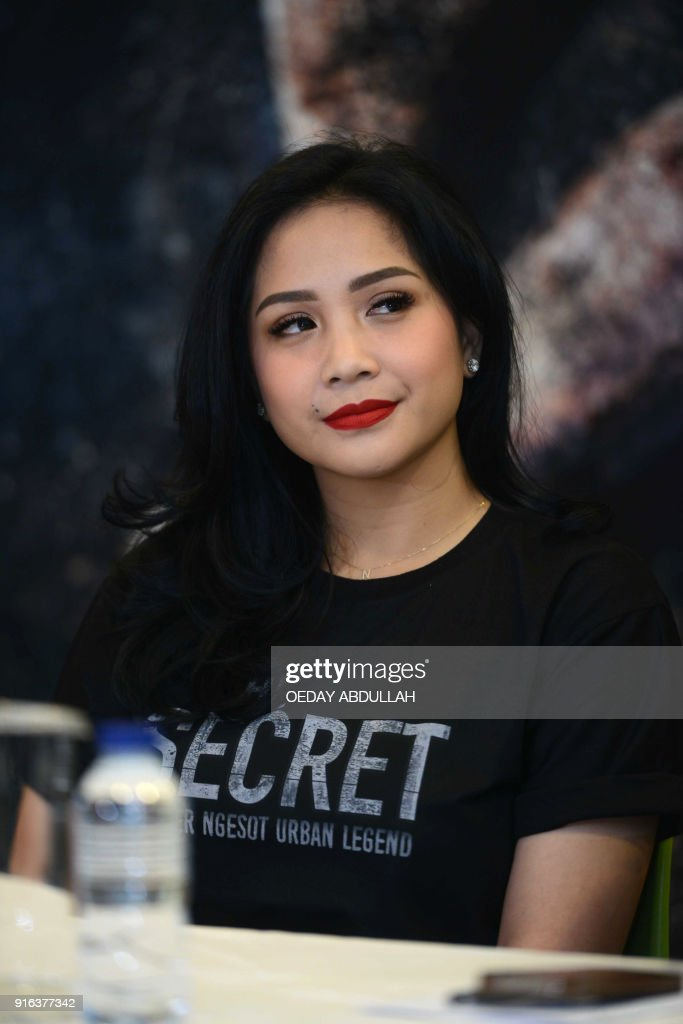 This picture taken on february 9 2018 shows indonesian actress this picture taken on february 9 2018 shows indonesian actress nagita slavina posing during a reheart Images