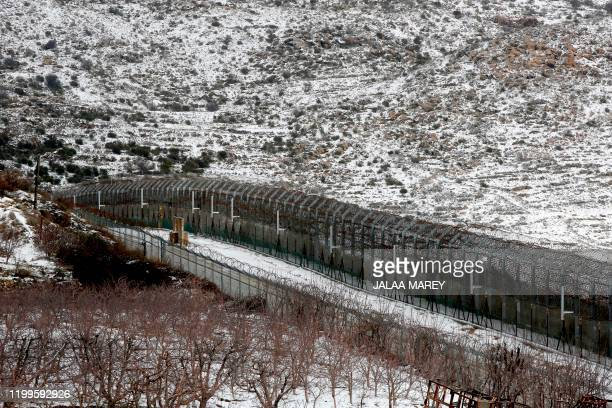 This picture taken on February 9 2020 shows a view of the border fence with Syria in the Israeliannexed Golan Heights near the village of Majdal...