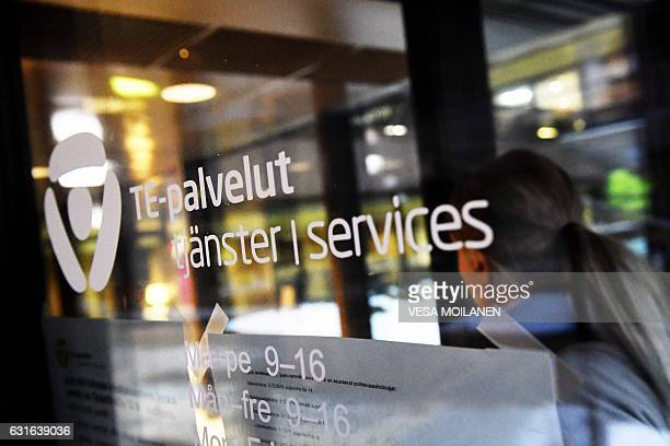 This picture taken on January 10 2017 shows a client entering the Employment Agency in Helsinki Finland As of January 1 a twoyear experiment will see...