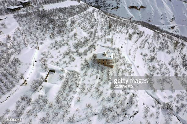 This picture taken on January 10 2019 shows an aerial view of a snowcovered valley of the Cedars area in the Lebanese mountains norh of Beirut 1800...
